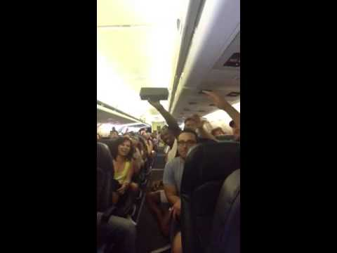WATCH: Passengers stranded on Tarmac band together to sing R. Kelly