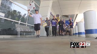 Tulsa American Airlines employees picket with Dallas peers