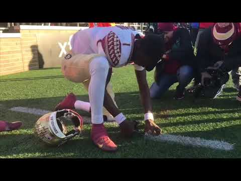 FSU QB James Blackman collects the sod at Boston College after FSU's victory as an underdog