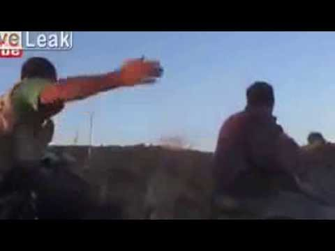 FSA rebel takes a bullet to the face from Syrian Army sniper.