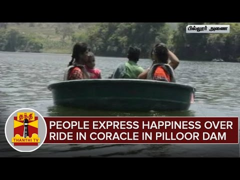Suuzhal-Tourist--People-Express-Happiness-Over-Ride-in-Coracle-Parisal-at-Pilloor-Dam