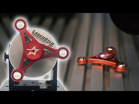 <h3>Laser Engraving Anodized Aluminum | Customizing A Fidget Spinner</h3><p>Our FiberCube Laser Engraving Systems can transform any alloy blank into a custom branded product in minutes. Anodized aluminum, power coated steel, Titanium, and precious alloys just to name a few. Take a look at this anodized aluminum fidget spinner that we laser engraved. That crystal clear, permanent engraving was done completely with the laser with no need for paint or toxic chemicals. Want to learn more about the FiberCube Laser Engraving System? Contact LaserStar today!<br /><br />Our proprietary StarFX&trade; software provides a level of complex layer engraving and surface texturing never before available in today&rsquo;s marketplace.&nbsp; Convert any sketch, drawing, or graphic image into a custom engraved work-of-art on multiple alloys including: Aluminum, Stainless Steel, Titanium, Copper, Iron, Brass, Exotic Metals, Composites, and precious alloys.&nbsp; Each image can be engraved before or after custom coating (including hard coat anodize, custom color or Cerakote processes) to optimize the color fill, natural shadowing and polishing effects of the final result.</p>
