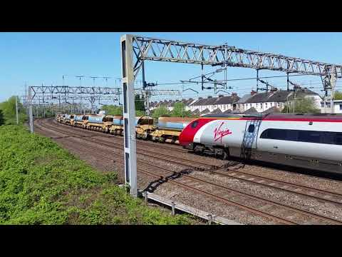 Stafford Railway Station Queensville Curve 66614 FL passes 390114 VT Pendolino on the 10th May 2018