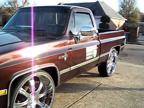 85 chevy c-10 on 28s posted up