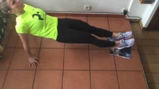 Apertura y cierre de piernas con cadera elevada