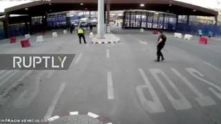 """A police officer sustained light injuries after apprehending a man wielding a large knife on the border between Morocco and the Spanish enclave of Melilla on Tuesday morning. According to police sources he shouted """"God is Great"""" and """"Al Hoceima, freedom"""", referring to a city in northern Morocco in Arabic.The assailant was taken out by a plastic traffic barrier before colleagues restrained him. The officer injured a finger in the incident which was captured on CCTV.Video ID: 20170725 010Video on Demand: http://www.ruptly.tvContact: cd@ruptly.tvTwitter: http://twitter.com/RuptlyFacebook: http://www.facebook.com/Ruptly"""