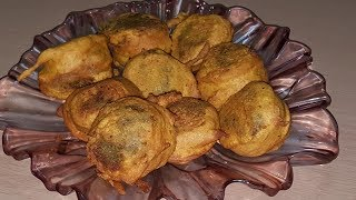 Ingredients:Potato 2 boiled ans mashed,Gram flour 1 cup, corriander 1/4 bunch,green chilli 3, coconut powder 2 tb sp.salt to taste,turmeric 1/2 tsp,crush red chilli 1 tsp,cumin powder 1 tsp,baking powder 1/4 tsp,food colour pinch,mustard seeds 6 to 8,curry leaves few,rai seeds few, oil for frying garlic 1 tsp..