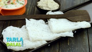 Neer Dosa,Recipe Link : https://www.tarladalal.com/Neer-Dosa-(--Idlis-and-Dosas)-37910rSubscribe : http://goo.gl/omhUioTarla Dalal App: http://www.tarladalal.com/free-recipe-app.aspxFacebook: http://www.facebook.com/pages/TarlaDalal/207464147348YouTube Channel: http://www.youtube.com/user/TarlaDalalsKitchen/featuredPinterest: http://www.pinterest.com/tarladalal/Google Plus:  https://plus.google.com/107883620848727803776Twitter: https://twitter.com/Tarla_DalalNeer DosaNothing like this Neer Dosa to soothe your palate! Made with a simple batter of raw rice, this dosa has a soothing flavour and a mildly chewy texture that is very appealing. The batter for this dosa does not require any fermentation. Although simplicity is the highlight of the Neer Dosa, it requires a bit of expertise to prepare it perfectly. Make sure the tava is really hot before pouring the batter, and ensure the dosa is cooked well before you try to remove it, else you will end up with bits and pieces instead of a nice, big dosa! If you like a bit of spice, serve it with coconut chutney or vegetable stew, else combine it with sweetened coconut churna. As a variant, grind some grated coconut along with the rice, for an even softer dosa.Preparation Time: 5 minutes.Cooking Time: 10 minutes.Makes 10 dosas.  Soaking Time: 2 hours. 1 cup raw rice (chawal), soaked for 2 hours and drainedSalt to tasteOil for greasing1. Combine the drained raw rice and ½ cup of water in a mixer and blend till smooth.2. Transfer the mixture into a deep bowl, add 1 cup of water and salt and mix well.3. Heat a non-stick tava (griddle) till red hot, sprinkle a little water on the tava (griddle) and wipe it off gently using a muslin cloth.4. Grease the tava (griddle), with a little oil and pour approx. 5 tbsp of the batter on it and tilt the tava (griddle), in a circular motion to make a round dosa.5. Cover with a lid and cook on a medium flame for 1 minute. Fold the dosa into a triangle.6. Repeat with the remaining batter to mak