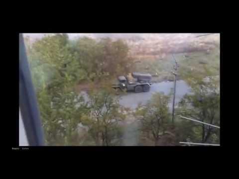 30 09 2014 Боевики 'Оплота' открывают огонь из Града в жилых кварталах Докучаевска  Видеофакт