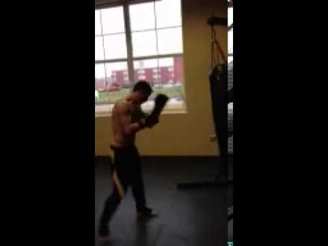 SSF Submission Academy - Steven getting a quick workout in on the Heavy bag.