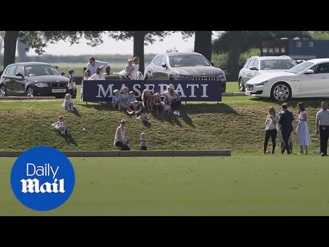 Prince George gets pushed down the hill by his cousin at polo match - Daily Mail