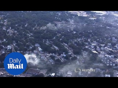 Aerial footage shows dozens of fires burning after gas explosions