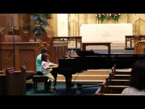 One of our piano students playing a duet with his teacher