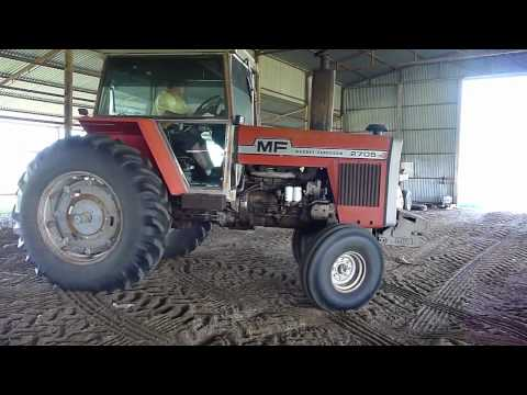 tractor - Massey Fergason 2705 Farm Tractor raking hay. Be shure to watch in HD and hit subcribe.