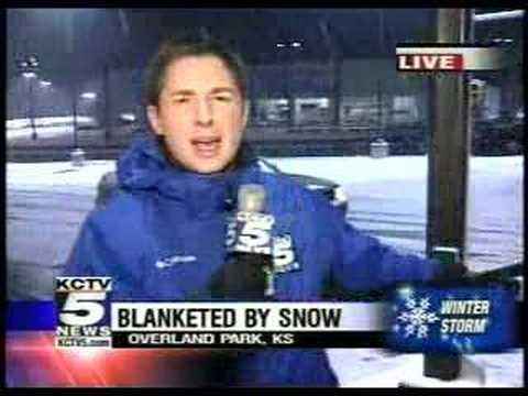TV cameraman falls down during live shot