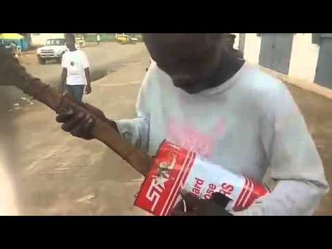 Video Blind Liberian Man Sings Reggae With Stick and Oil Can Guitar download in MP3, 3GP, MP4, WEBM, AVI, FLV January 2017