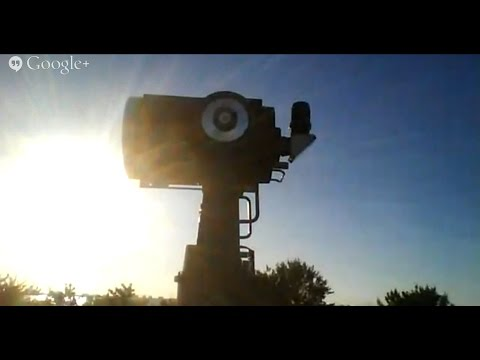 solar - Live webcast of the partial solar eclipse as the sun is setting from Florida. At 25:47 there is an unidentified flying object in front of the sun.