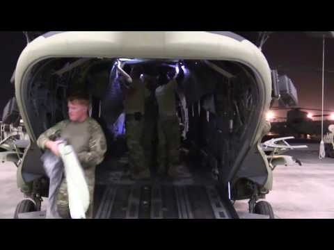 Maintainers prep, clean and inspect a Chinook aircraft during an inspection phase