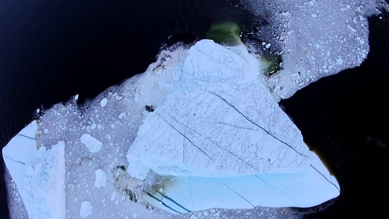 Beautiful RARE Aerial Video of IceBerg collapse!!