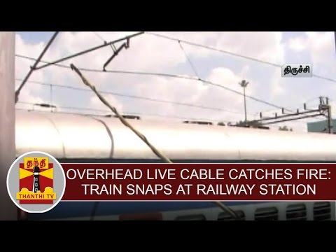 Overhead-live-cable-catches-fire-Train-snaps-at-railway-station-Thanthi-TV