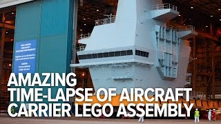 Amazing time-lapse of aircraft carrier Lego-like assembly