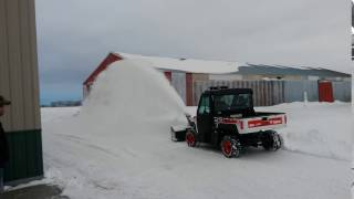 3. Bobcat 3650 Utility Vehicle blowing snow