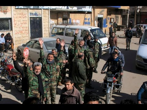 Syrian soldiers enter the towns of Nubul and Al Zahraa near Aleppo.