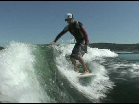 Sean riding Inland Surfer boards behind Centurion Enzo