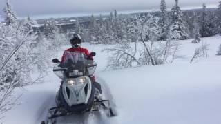 8. Snowmobile climbing mountain