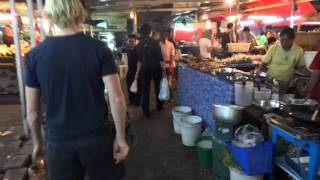 Eating Out In Bangkok At A Local Outdoor Food Court Located Near
