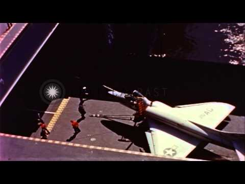Link to order this clip: http://www.criticalpast.com/video/65675042344_United-States-Gruman-Tigers-aircraft_Regulus-missile_hangar-deck_refueling-a-ship Historic...