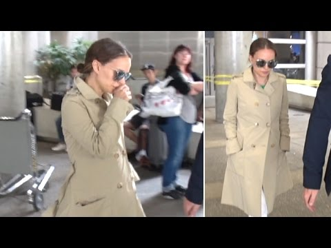 Pregnant Natalie Portman Covers Up With Trench Coat At LAX