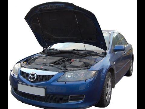 Mazda 6 газовый упор капота фотка