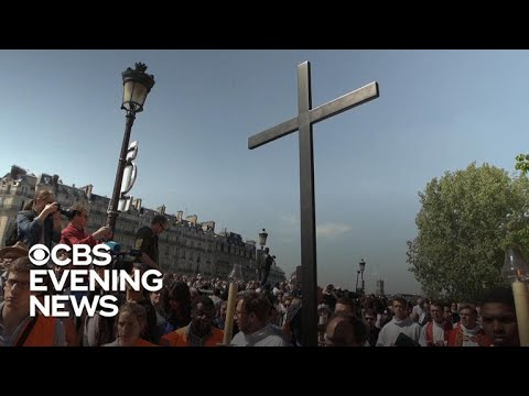 Good Friday procession held outside Notre Dame Cathedral