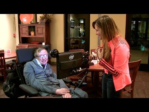 A physics grad student is granted one question with Stephen Hawking, who smiles broadly when she asks for a hug