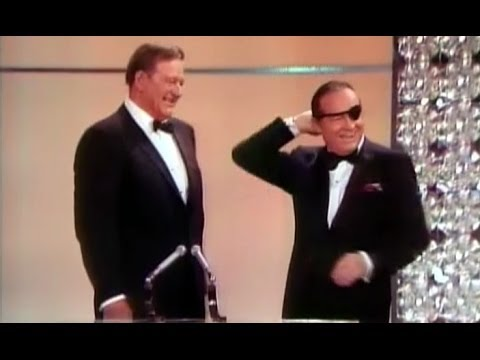 1970 - Bob Hope opens the 42nd Academy Awards in 1970, featuring an introduction from Academy President Gregory Peck and appearances from John Wayne, Myrna Loy, Cli...