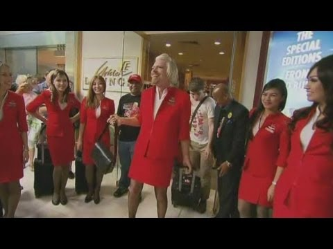 Branson dresses as an air hostess after losing bet with AirAsia boss