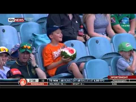 Boy eats Whole Watermelon at a Cricket Game