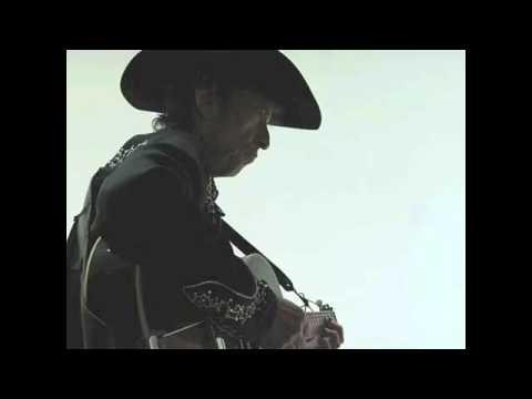 Tekst piosenki Bob Dylan - Standing in the doorway po polsku