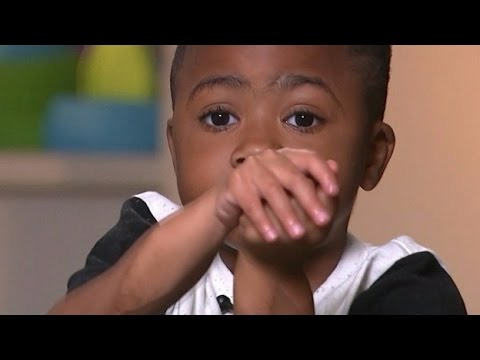 Boy with world's first double-hand transplant one year on