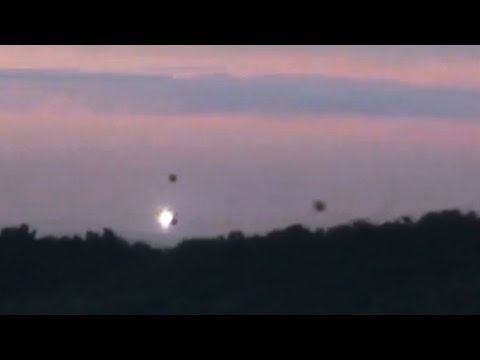 disturbing ufo activity! 3 ufos landing in forest!