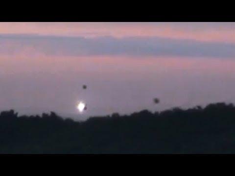 disturbing ufo activity! 3 ufos landing in forest!