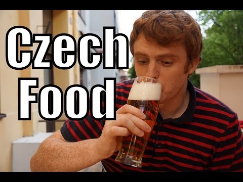 Eating Czech Food including Goulash and Pilsner Beer