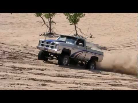 Chevys attempt sandy hill climb in 2WD