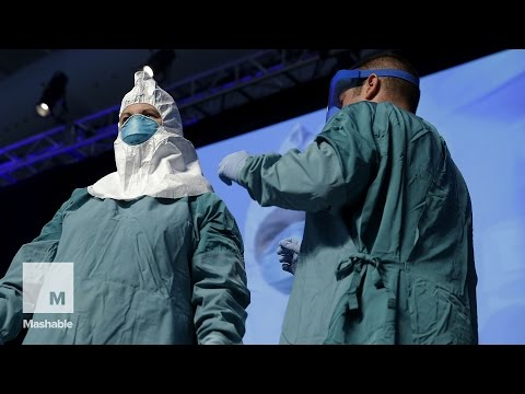 steps - Wearing and removing the protective gear for Ebola health care workers is a tedious process. Nurse Barbara Smith and Dr. Bryan Christensen demonstrate the recommended way for U.S. health care...