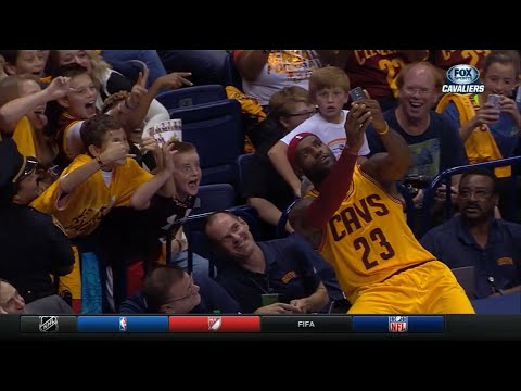 LeBron James takes selfie with fans DURING GAME TIMEOUT!