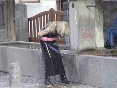 helga in wet rubber apron