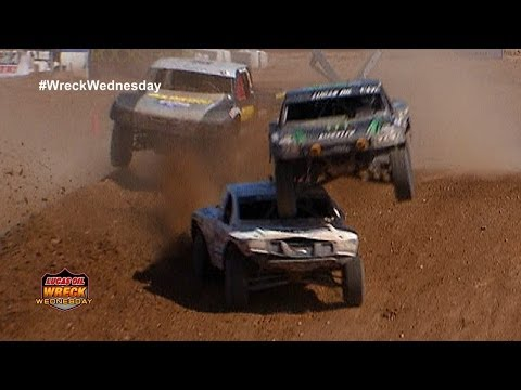 Jeremy McGrath lands on top Carl Renezeder while racing their off road trucks - WW #3