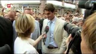 Roger Federer interviewed by a excited female Swiss reporter.