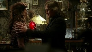 Rumple returns Belle's heart.